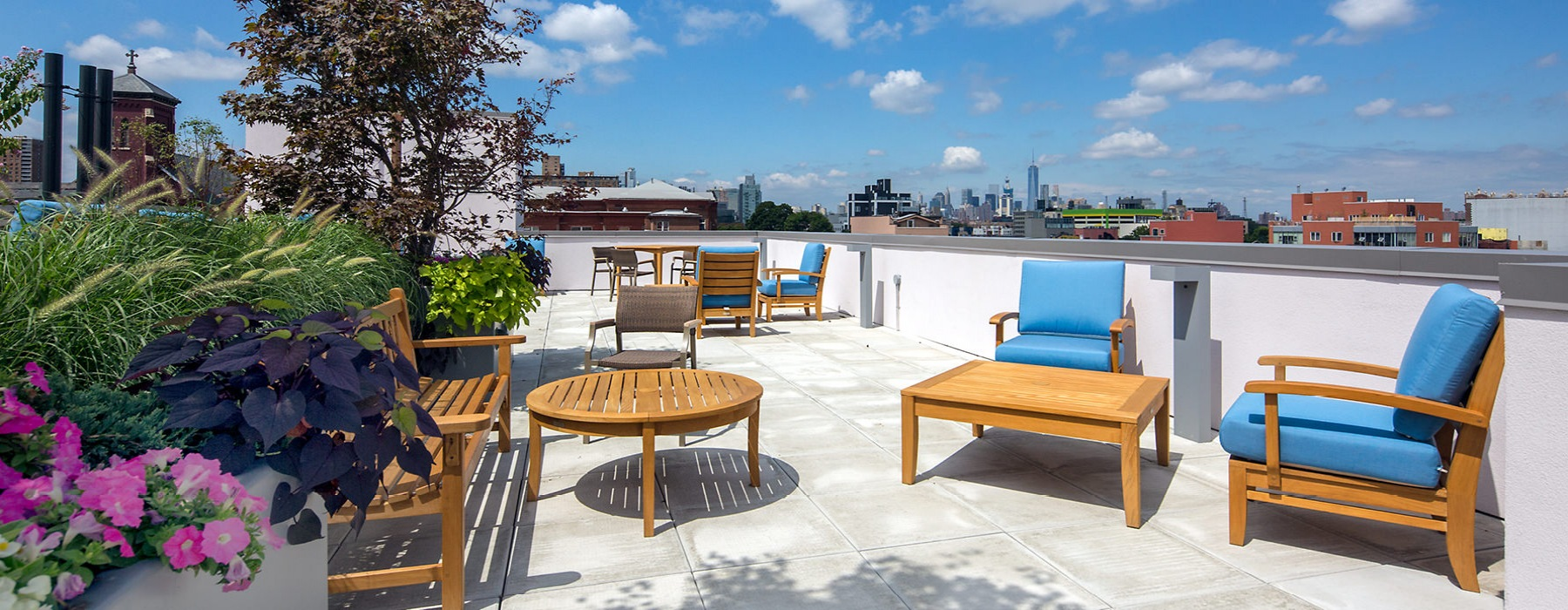 Rooftop lounge with Adirondack chairs and tables